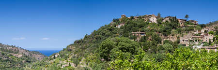 hilltop: Panorama of the hilltop village of Deia Mallorca Baleares Spain Stock Photo