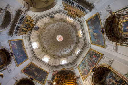 surmounted: Interior of Santa Maria Della Pace. The interior has a short nave with cruciform vaulting and a tribune surmounted by a cupola.