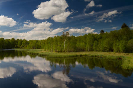 hessen: Clouds reflecting at the Lake Rotes Moor, Rhoen, Hessen, Germany