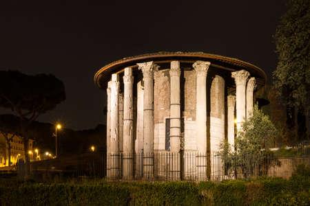 fortuna: Roman hercules temple at night, Rome, Italy Stock Photo