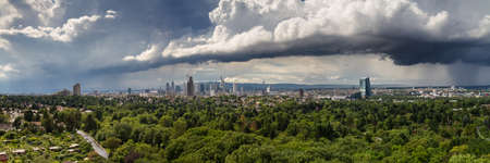 lightbeam: Panorama of the Rhein Main Valley with the skyline of Frankfurt and dramtic clouds, Hessen, Germany
