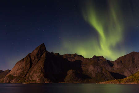 lofoten: Northern lights over Olstind mountain, Lofoten, Norway