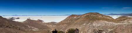 Panorama of the Salar de Uyuni as seen from a viewpoint of ancient ruins, Altiplano, Bolivia Stock Photo