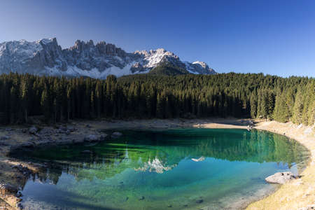 Lake Karersee in front of the mountain range Latemar, South Tyrol, Italy