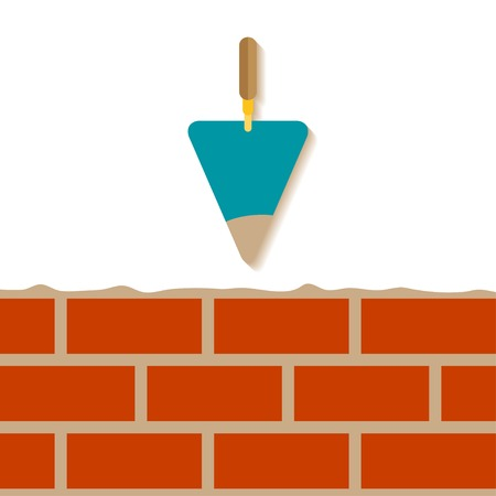 Cement trowel and brick wall isolated on white background