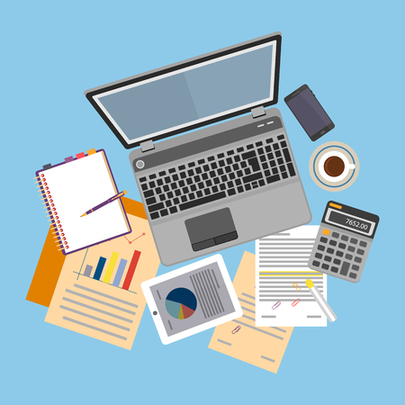 auditing: Top view of workplace with documents and laptop.