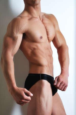 hombres musculosos: Hombre Atl�tico con abs consisten  Foto de archivo