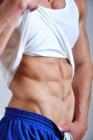 beach hunk: Athletic man with six-pack abs
