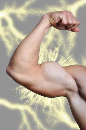 flex: Close up of mans arm showing biceps