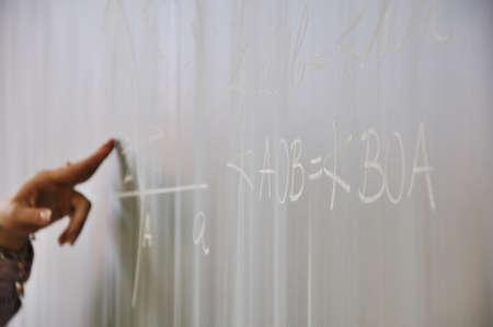 Teaching math on blackboard photo