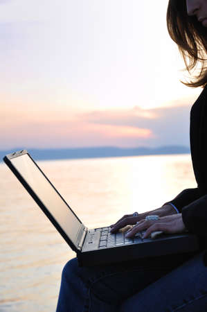 Sunset and business woman  photo