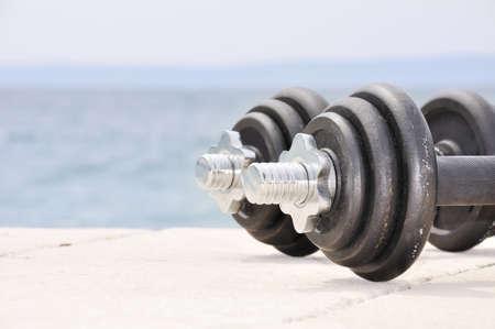 Dumb bells on the beach