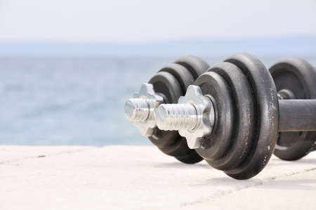 Dumb bells on the beach