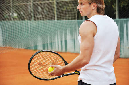 playing tennis: Young man playing tennis Stock Photo