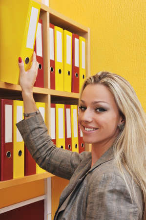 Business woman taking folder photo
