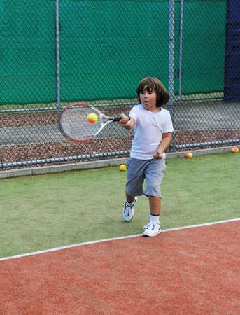Young boy play tennis