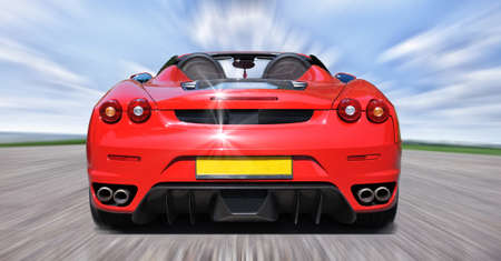 motorized sport: Red sport car on the road Stock Photo