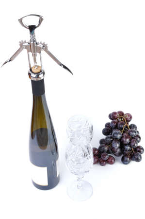 Bottle of wine with aperitive, glasses and grapes isolated in white photo
