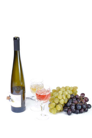 aperitive: Bottle with aperitive, glasses of wine and grapes isolated in white