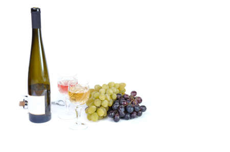 aperitive: Bottle of wine with aperitive, glasses of wine and grapes