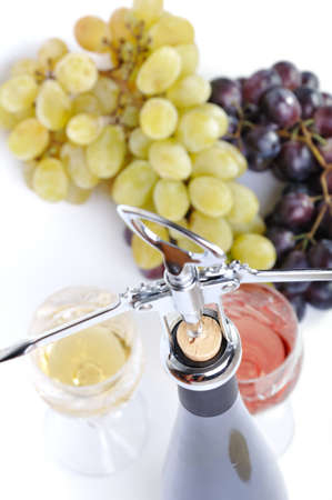 Bottle of wine with aperitive, glasses of wine and grapes isolated in white Stock Photo - 10557062
