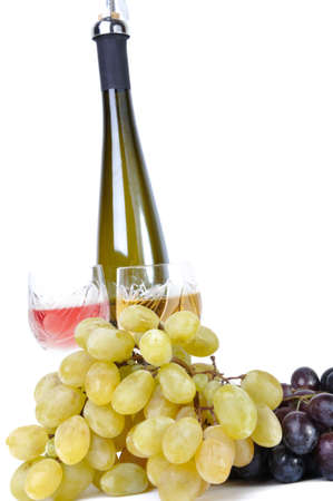 Bottle of wine with aperitive, glasses of wine and grapes isolated in white photo