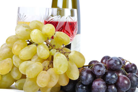 Bottle of wine with glasses of wine and grapes isolated in white photo
