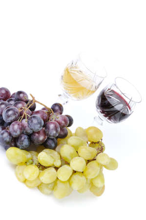 Glasses of wine with grapes isolated in white photo