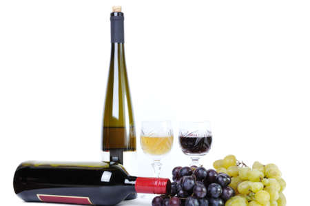 Two bottles of wine with two glasses of wine and grapes isolated in white photo