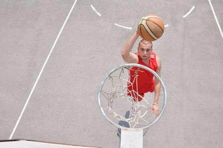 Basketball player shooting photo