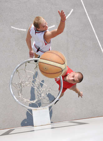 Two basketball players on the court photo