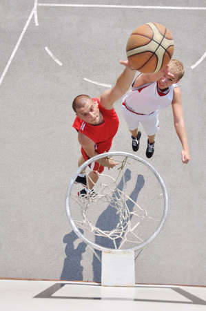 point and shoot: Two basketball players on the court Stock Photo