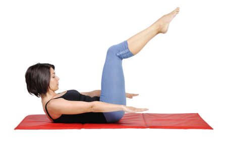 Fit young female pilates instructor showing different exercises on a white background  Banque d'images
