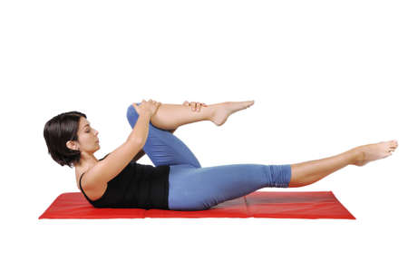 muscle toning: Fit young female pilates instructor showing different exercises on a white background  Stock Photo