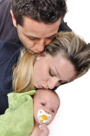 Portrait of a young happy family with the kid on a white background photo