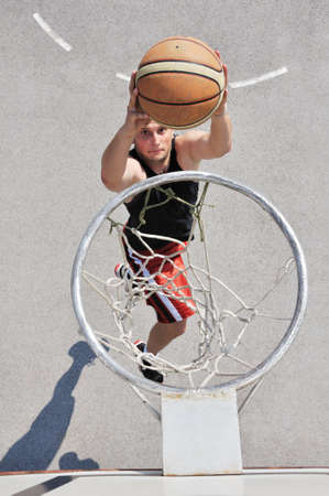 Basketball player shooting the ball photo