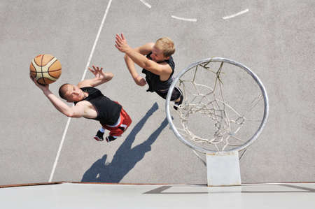 hand baskets: Two basketball players on the court Stock Photo