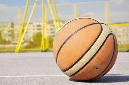 static: Static basketball iluminating by sunlight