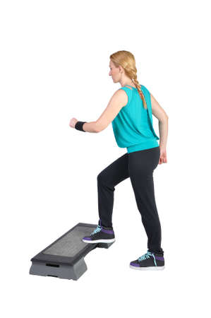 Fit young female aerobic instructor showing different exercises on a white background photo