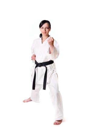martial arts woman: Karate woman posing on a white background