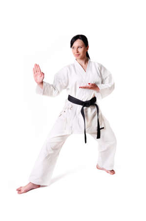 art activity: Karate woman posing on a white background
