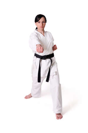 girl punch: Karate woman posing on a white background