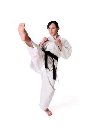 defense: Karate woman posing on a white background