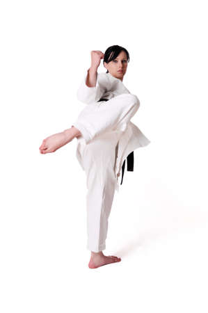 self defence: Karate woman posing on a white background