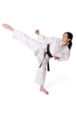 Karate woman posing on a white background Stock Photo - 14431076