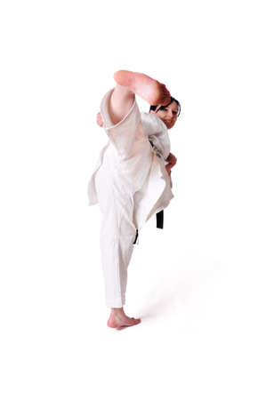 Karate woman posing on a white background photo