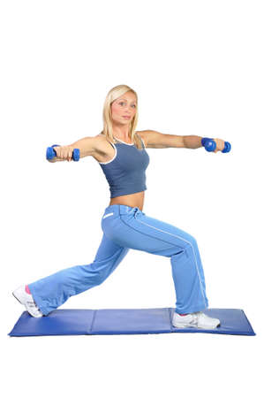 toning: Fit young female pilates instructor showing different exercises on a white background