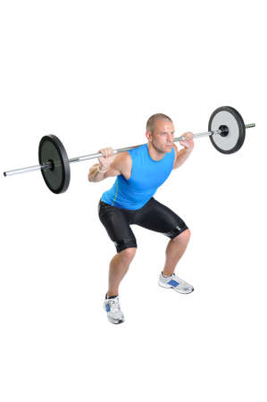 squat: Muscular athlete man exercising on a white background