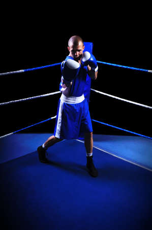circular muscle: Male boxer in ring doing exercise Stock Photo
