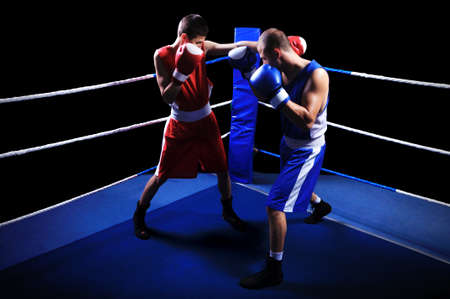 Two male boxers fighting in ring
